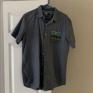 Blue short sleeve button-up.